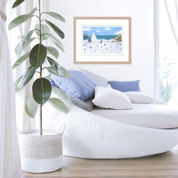 The limited edition print At the Beach in situ in a white light beach themed decore