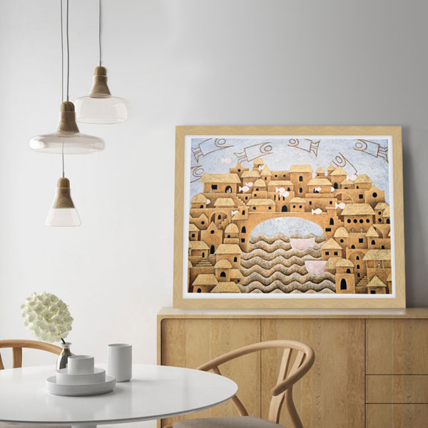 A framed limited edition print of the coloured pencil drawing in a sandy coloured beachy wood room