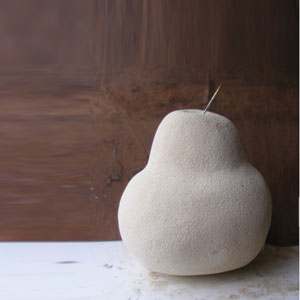 This is a photograph of one of my latest concrete sculptures - a pear - I am calling the art series - stone fruit -
