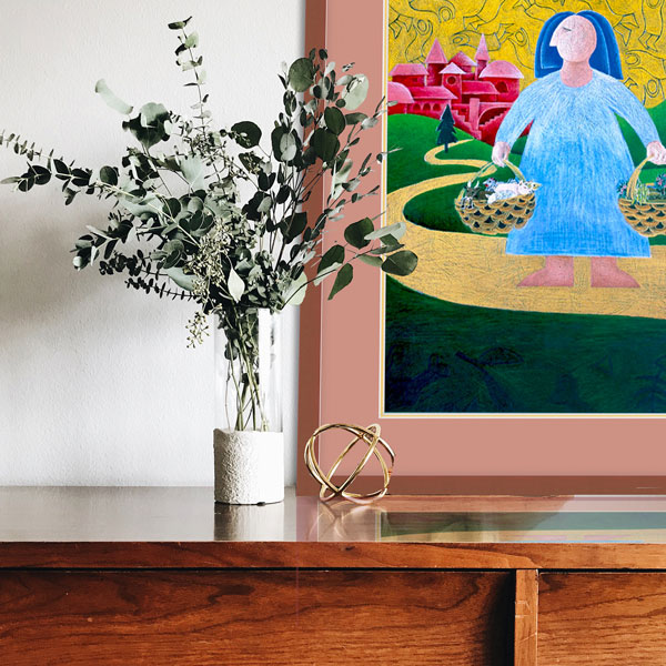 the framed print of going shopping in a darker, more natural wood theme - and there are some natural earthy green leaved plants in a vase on a dark grained buffet