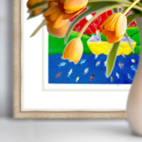 The print Going Fishing in a light wooden frame behind yellow flowers