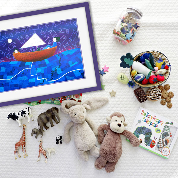 A joyful picture of the print of sailing through life in a purple frame surounded by childrens toys