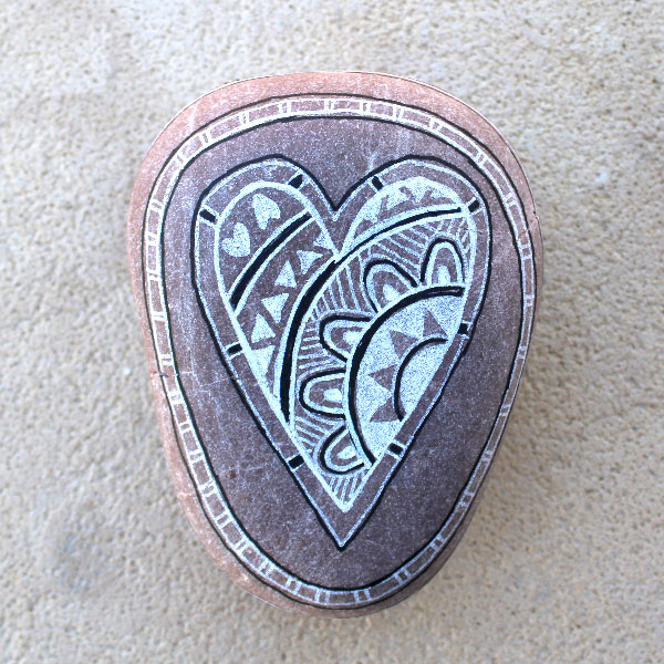 a hand painted stone by Mandy