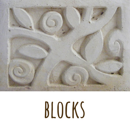 a carved cement block sculpted by Mandy with a rose pattern