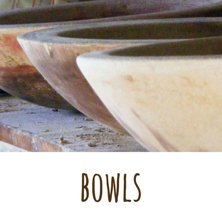 a view of some of Mandys hand made cement bowls in the afternoon light of her studio