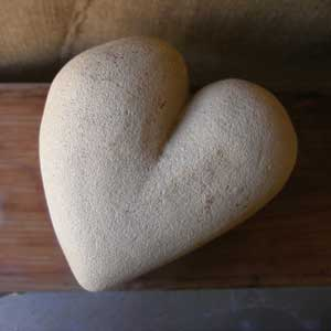 a sculpted cement love heart made by Mandy Evans Artist
