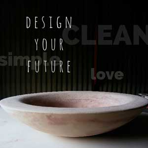one of Mandys gorgeous cement bowls in a dramatic dark setting with the words - design your future