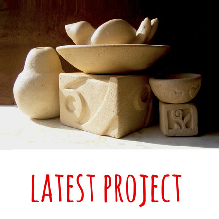 a collection of bowls, sculptures and blocks made by Mandy Evans Artist